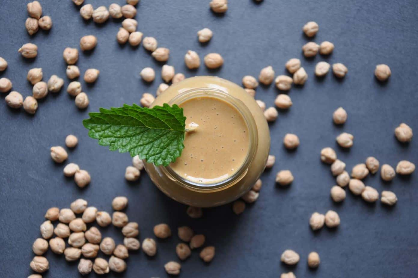 Is it cheaper to buy tahini homemade tahini paste with chickpeas in background