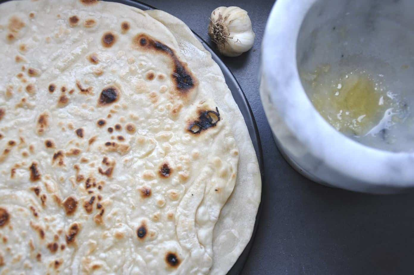 baked Indian flatbread dough, roti, naan, chapati or paratha with garlic
