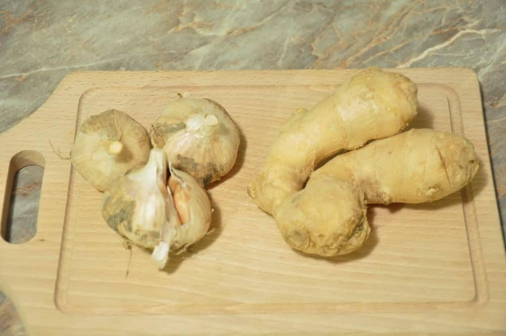 ginger and garlic on wooden board