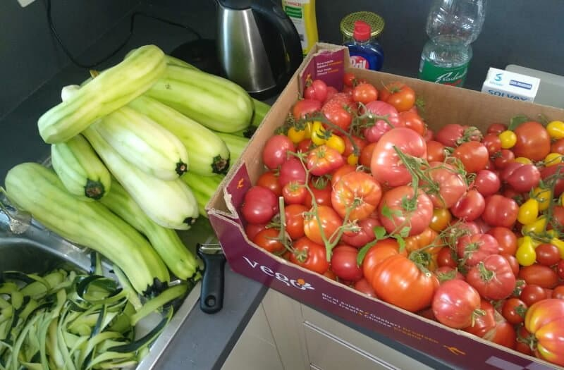 a lot of overgrown courgettes or zucchini peeled with tomatoes
