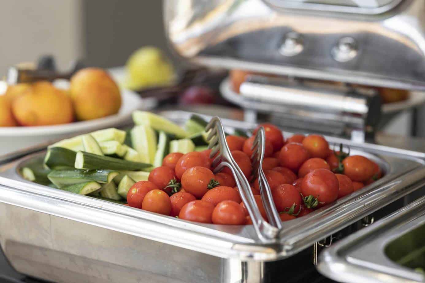 zucchini and cherry tomatoes in chafing dish