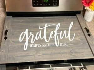 noodle board saying grateful hearts gather here
