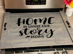 noodle board stove top cover saying home is where our story begins