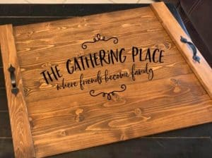 noodle board stove top cover saying the gathering place where friends become family