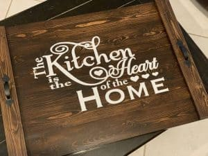 noodle board saying the kitchen is the heart of the home