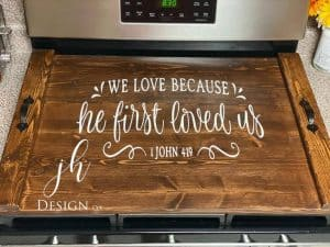 noodle board stove cover saying we love because he first loved us john 4 19