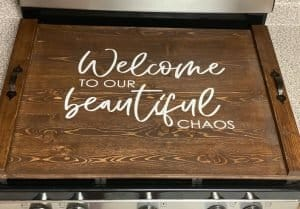 noodle board stove cover saying welcome to our beautiful chaos
