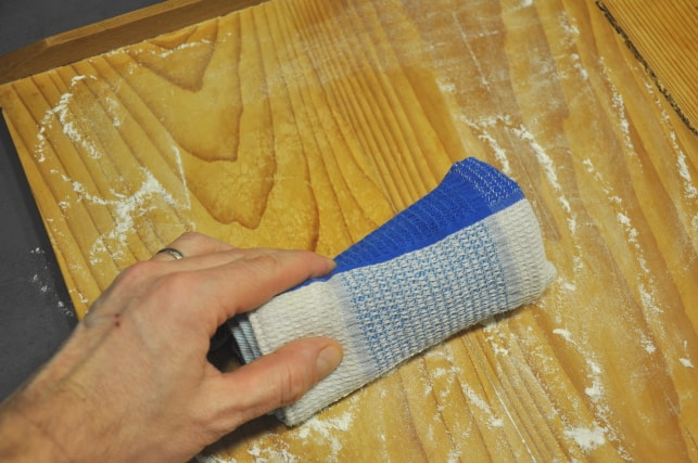 cleaning pasta board Dust off flour from pasta board